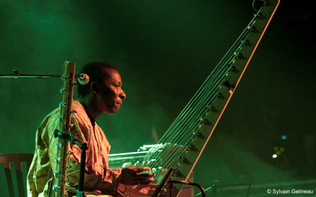 Djeli Moussa Diawara with kora on stage
